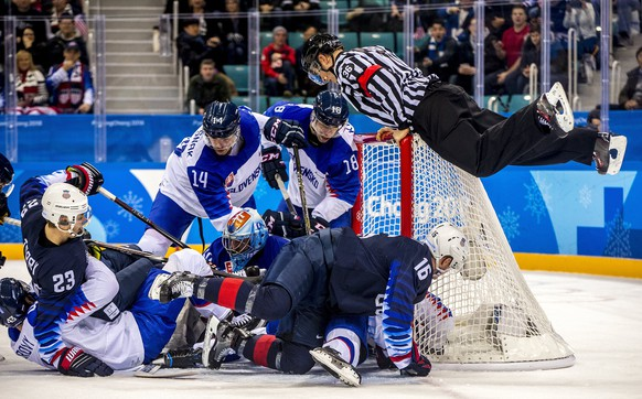 epaselect The referee hoists himself up on the net during the mens preliminary round match between USA and Slovakia at the Gangneung Hockey Centre at the PyeongChang Winter Olympic Games 2018, in Gangneung, South Korea, 16 February 2018. The PyeongChang 2018 Winter Olympic Games, will run from 09 to 25 February 2018.  EPA/SRDJAN SUKI