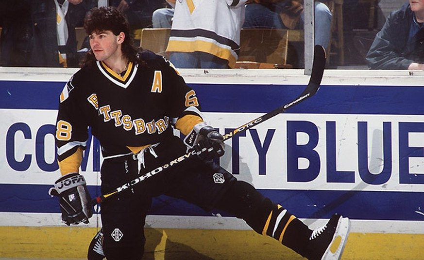 21 Feb 1996:  Jaromir Jagr of the Pittsburgh Penguins kneels on the ice during a 6-3 loss to the Buffalo Sabres at the Aud in Buffalo, New York. Mandatory Credit: Harry Scull/Allsport