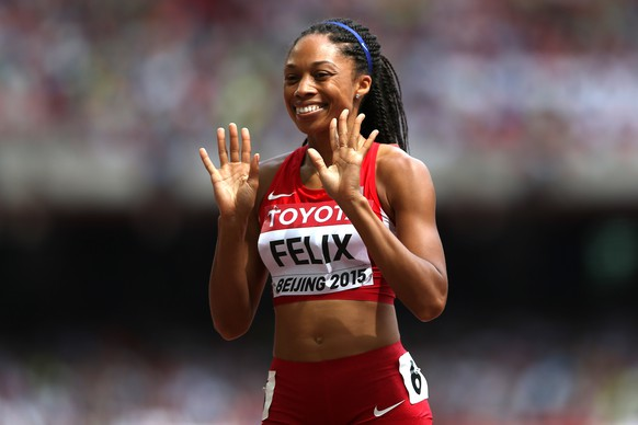 CORRECTED VERSION: BEIJING, CHINA - AUGUST 24:  Allyson Felix of the United States reacts after competing in the Women's 400 metres heats during day three of the 15th IAAF World Athletics Championships Beijing 2015 at Beijing National Stadium on August 24, 2015 in Beijing, China.  (Photo by Patrick Smith/Getty Images)