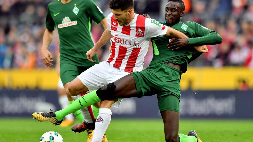 epa06282133 Bremen's Lamine Sane (R) in action against Cologne's Milos Jojic (L) during the German Bundesliga soccer match between FC Cologne a Werder Bremen at Rheinenergiestadion in Cologne, Germany, 22 October 2017.  EPA/SASCHA STEINBACH EMBARGO CONDITIONS - ATTENTION: Due to the accreditation guidelines, the DFL only permits the publication and utilisation of up to 15 pictures per match on the internet and in online media during the match.