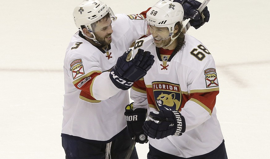 Florida Panthers defenseman Keith Yandle (3) and right wing Jaromir Jagr (68), from the Czech Republic, celebrate after the team's NHL hockey game against the San Jose Sharks in San Jose, Calif., Wednesday, Feb. 15, 2017. The Panthers won 6-5 in overtime. (AP Photo/Jeff Chiu)