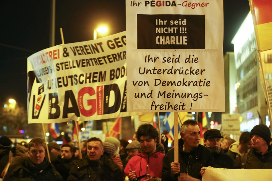 Members of BAGIDA, the Bavarian section of the anti-immigration movement Patriotic Europeans Against the Islamisation of the West (PEGIDA), march in the centre of Munich, January 19, 2015. The texts read 'Violence free and united against religious and proxy wars on German ground! BAGIDA' and 'You are not!!! Charlie.'            REUTERS/Michael Dalder (GERMANY  - Tags: POLITICS CIVIL UNREST)