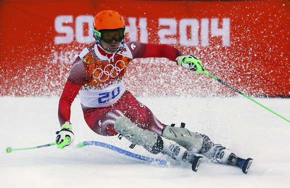 Switzerland's Sandro Viletta competes in the slalom run of the men's alpine skiing super combined event at the 2014 Sochi Winter Olympics at the Rosa Khutor Alpine Center February 14, 2014. REUTERS/Ruben Sprich (RUSSIA  - Tags: SPORT SKIING OLYMPICS)