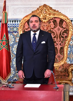 epa04866463 The Morocco King Mohammed VI (L), prepares to deliver a speech as he celebrates his 16th year of rule on Throne Day, Rabat, Morocco, 30 July 2015. In a speech delivered by Mohammed VI, the King noted that more needed to be done to assist the the poor and marginalized in the country.  EPA/STR