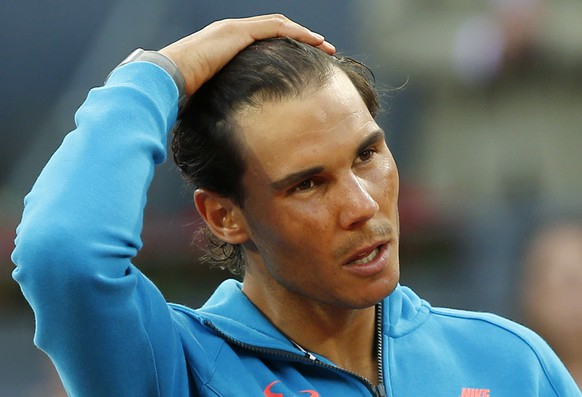 Rafael Nadal of Spain makes a speech after losing to Andy Murray of Britain during the men's final at the Madrid Open Tennis tournament in Madrid, Spain, Sunday, May 10, 2015. (AP Photo/Paul White)