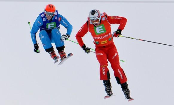 Winner Alex Fiva of Switzerland, front, and second placed Johannes Rohrweck of Austria during the final race of the men's Ski Cross  World Cup in Kreischberg, Austria, on Saturday, Jan. 25. 2014. (AP Photo/Kerstin Joensson)