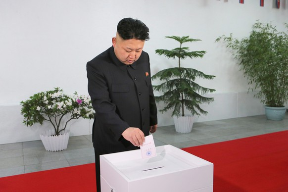 epaselect epa04118080 A picture released by the North Korea Central News Agency (KCNA) on 10 March 2014 shows North Korean leader Kim Jong-un casting a ballot at a polling station at the Kim Il-sung University of Politics in Pyongyang, North Korea, 09 March 2014, to elect the Supreme People's Assembly. It is the first election for the North's rubber-stamp parliament since Kim took over power in December 2011 after the death of his father Kim Jong-il. The election is held every five years.  EPA/KCNA SOUTH KOREA OUT