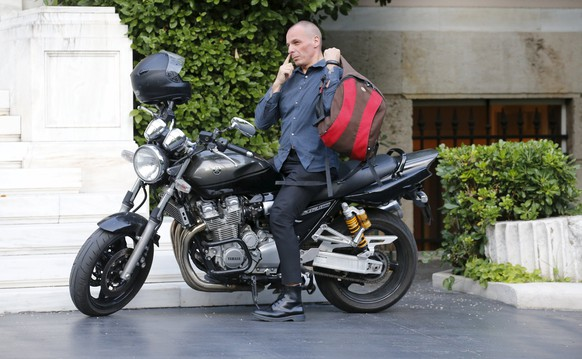 Greek Finance Minister Yanis Varoufakis arrives on his motorbike prior to a meeting at the office of Prime Minister Alexis Tsipras in Maximos Mansion in Athens, Greece, July 1, 2015. Prime Minister Alexis Tsipras called on Greeks to vote 'no' in Sunday's referendum on a bailout package offered by creditors, in a defiant address that dispelled speculation he was rowing back on the plan under mounting pressure.     REUTERS/Jean-Paul Pelissier       TPX IMAGES OF THE DAY
