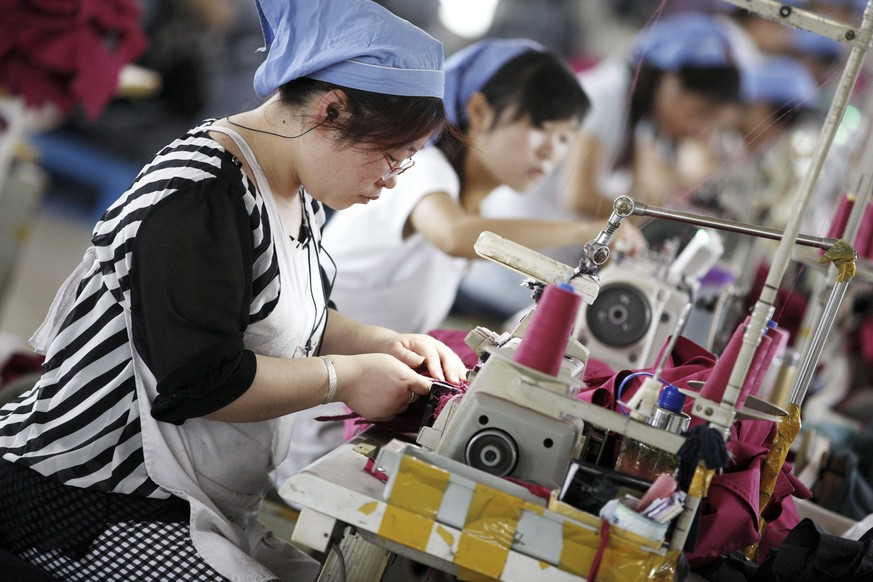 epa04778563 Female workers make clothes for export to Germany at a clothing factory in Huaibei, Anhui province, east China, 01 June 2015. China's official purchasing managers' index (PMI) rose to 50.2 in May from 50.1 in April, reports stated. A survey from financial services company HSBC showed China's total new business fell for the third month running as new export business fell at the sharpest rate in two years. HSBC's purchasing manager's index posted 49.2 in May, up from 48.9 in April.  EPA/STRINGER CHINA OUT
