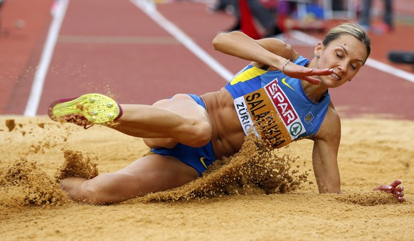 Olga Saladukha of Ukraine competes in the women's triple jump final during the European Athletics Championships at the Letzigrund Stadium in Zurich August 16, 2014. REUTERS/Phil Noble (SWITZERLAND  - Tags: SPORT ATHLETICS)