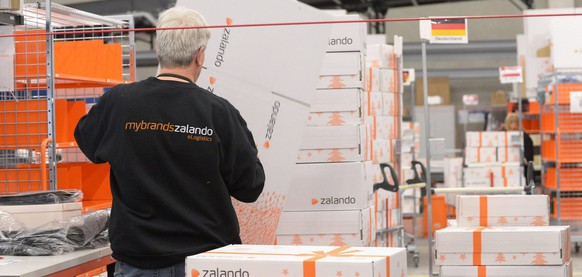 epa03920641 (FILE) A file photo dated 12 December 2012 showing an employee packing articles in the Zalando logistics centre in Erfurt, Germany. According to the company, the centre is, with 120,000 square meters, the largest logistics centre for shoes and fashion in Europe. Reports on 23 October 2013 state German online fashion shop Zalando has reported a strong growth and a turnover increase of some 70 per cent within just one year. The company reportedly achieved a net income of 437 million euro in second quarter 2013, compared with 257 million euro a year before. Half-year 2013  turnover was 809 million euro compared to 471 million euro a year before.  EPA/MARTIN SCHUTT