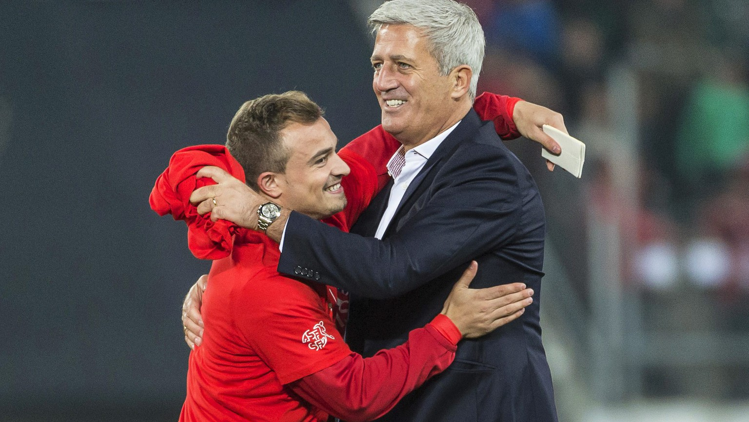 epa04971098 Swiss head coach Vladimir Petkovic (R) celebrates with Xherdan Shaqiri (L) after the UEFA EURO 2016 qualifying group E soccer match between Switzerland and San Marino in St. Gallen, Switzerland, 09 October 2015. Switzerland won 7-0.  EPA/ALESSANDRO DELLA VALLE