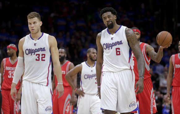 Los Angeles Clippers forward Blake Griffin, left, and center DeAndre Jordan react after a foul call during the second half of Game 6 in a second-round NBA basketball playoff series against the Houston Rockets in Los Angeles, Thursday, May 14, 2015, The Rockets won 119-107. (AP Photo/Jae C. Hong)