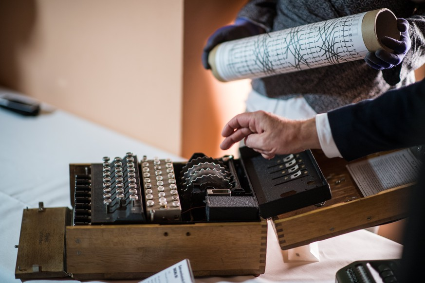 epa05952394 Employees show an Enigma M4 cipher machine from 1942 during a press preview at the Deutsches Museum in Munich, Germany, 09 May 2017. The Deutsches Museum received a cryptography collection from a German donator. The 30 exhibits will be part of an exhibition in late 2019.  EPA/CHRISTIAN BRUNA