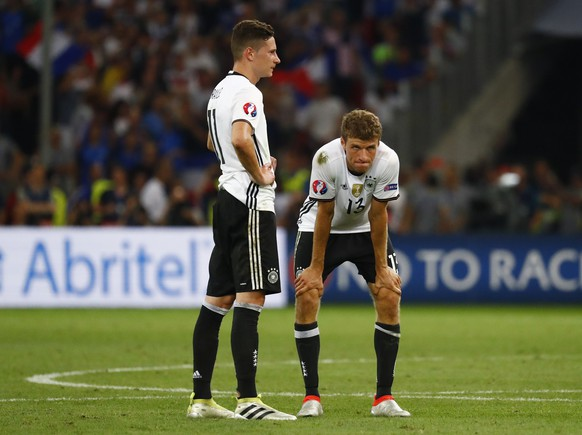 Football Soccer - Germany v France - EURO 2016 - Semi Final - Stade Velodrome, Marseille, France - 7/7/16 Germany's Thomas Muller and Julian Draxler react at the end of the match  REUTERS/Michael Dalder Livepic