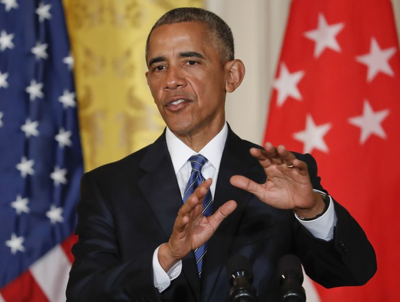 President Barack Obama answers questions during a joint news conference with Singapore's Prime Minister Lee Hsien Loong in the East Room of the White House in Washington, Tuesday, Aug. 2, 2016. Obama slammed Donald Trump as