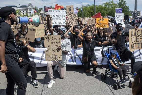 People demonstrate against racism after the worldwide movement of the Black Lives Matter (BLM) protest against the recent death of George Floyd in Zurich, Switzerland, 13 June 2020. Floyd, a 46-year-old African-American man, died on 25 May after being detained by police officers in Minneapolis (Minnesota), USA. (KEYSTONE/Ennio Leanza)