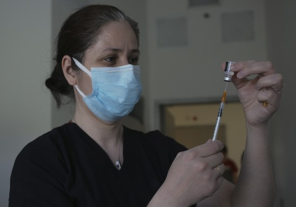 A nurse prepares to administer the second dose of Pfizer COVID-19 vaccine at a hospital, in Ankara, Turkey, Saturday, May 1, 2021.  Turkish President Recep Tayyip Erdogan imposed the new lockdown restrictions that will last until May 17, spanning the holy Muslim month of Ramadan and the Eid holiday, after COVID-19 infections and fatalities hit record high levels. (AP Photo/Burhan Ozbilici)