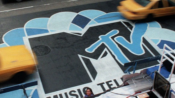 "FILE -- In this Sept. 3, 1996, file photo, traffic moves along 6th Avenue in New York, over the logo painted in the street outside Radio City Music Hall for the MTV Music Video Awards ceremony. MTV said it doesn't condone driving under the influence after a cast member was shown nodding off behind the wheel during the most recent episode of ""Teen Mom OG"" that aired June 26, 2017. (AP Photo/Todd Plitt, File)"