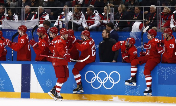 epa06548931 Mikhail Grigorenko (C) of Olympic Athletes from Russia celebrates a goal against Norway during the mens play-offs Quarterfinals match inside the Gangneung Hockey Centre at the PyeongChang Winter Olympic Games 2018, in Gangneung, South Korea, 21 February 2018. The PyeongChang 2018 Winter Olympic Games, will run from 09 to 25 February 2018.  EPA/LARRY W. SMITH