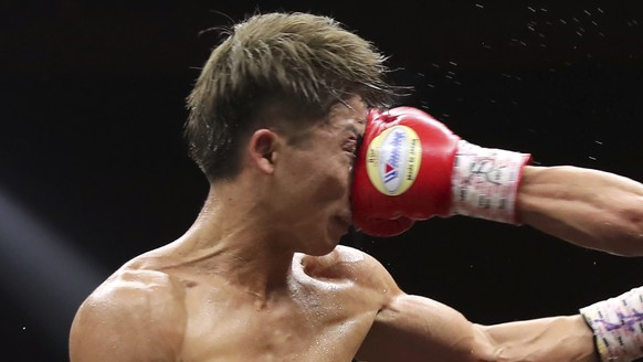 Japan's Naoya Inoue, left, gets a punch from Philippines' Nonito Donaire in the sixth round of their World Boxing Super Series bantamweight final match in Saitama, Japan, Thursday, Nov. 7, 2019. Inoue beat Donaire with a unanimous decision to win the championship. (AP Photo/Toru Takahashi)Naoya Inoue,Nonito Donaire