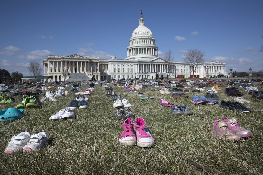 epaselect epa06601073 Approximately seven thousand shoes representing lost children to guns since the 14 December 2012 shooting at Sandy Hook Elementary School in Newtown, Connecticut, are seen on the East Front of the US Capitol in Washington, DC, USA, 13 March 2018. The 14 February shooting at Marjory Stoneman Douglas High School in Parkland, Florida, was the 17th school shooting in the US in 2018.  EPA/MICHAEL REYNOLDS