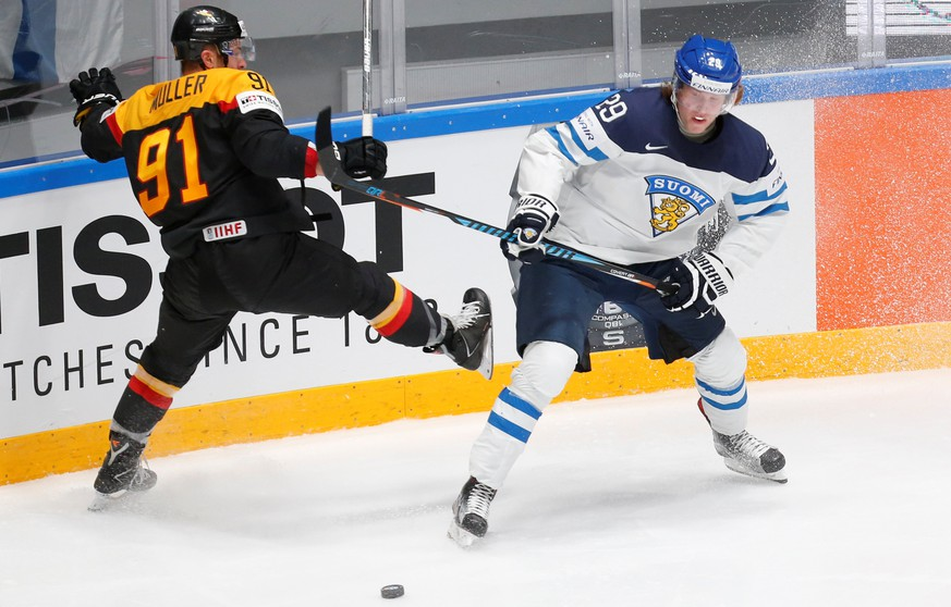 2016 IIHF World Championship - Group B - Finland v Germany - St. Petersburg, Russia - 8/5/16 - Patrik Laine of Finland in action with Moritz Muller of Germany. REUTERS/Maxim Zmeyev