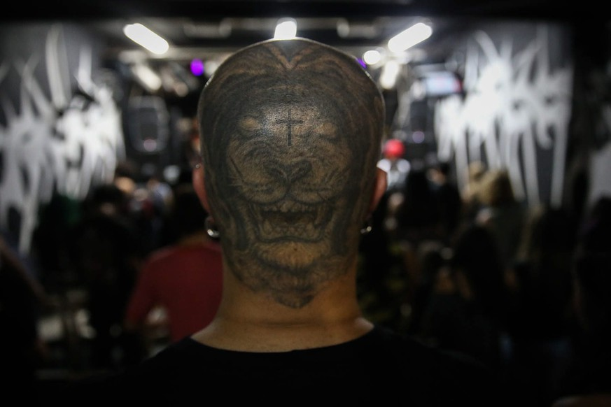 epa05713345 A picture available on 12 January 2017 shows the hair cut of a man during worship at the Crash Church in Sao Paulo, Brazil, 08 January 2017. In a garage in Sao Paulo, with the aesthetic of the heavy metal and the stridency of their guitars, the Crash Church was founded, usually visited by rock lovers surfing the words of the Lord through the music.  EPA/FERNANDO BIZERRA JR.