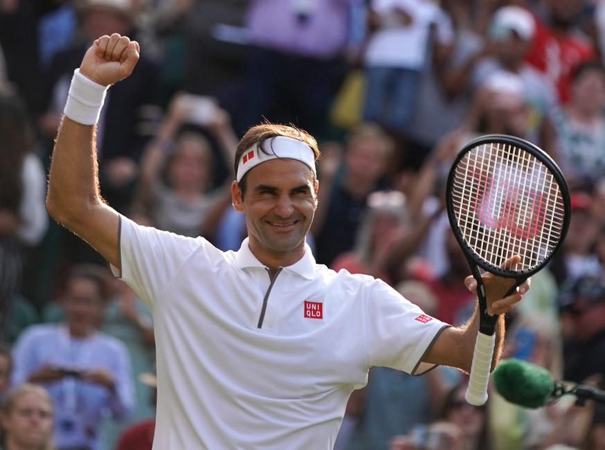 epa07708463 Roger Federer of Switzerland celebrates winning against Kei Nishikori of Japan during their quarter final match for the Wimbledon Championships at the All England Lawn Tennis Club, in London, Britain, 10 July 2019. EPA/NIC BOTHMA EDITORIAL USE ONLY/NO COMMERCIAL SALES