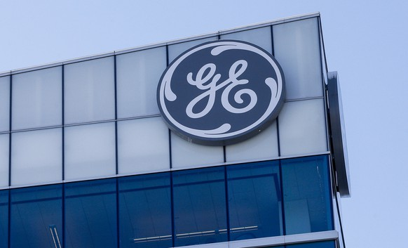 FILE - In this Jan. 16, 2018, file photo, the General Electric logo is displayed at the top of their Global Operations Center in the Banks development of downtown Cincinnati. General Electric Co. reports financial results Tuesday, April 30, 2019. (AP Photo/John Minchillo, File)