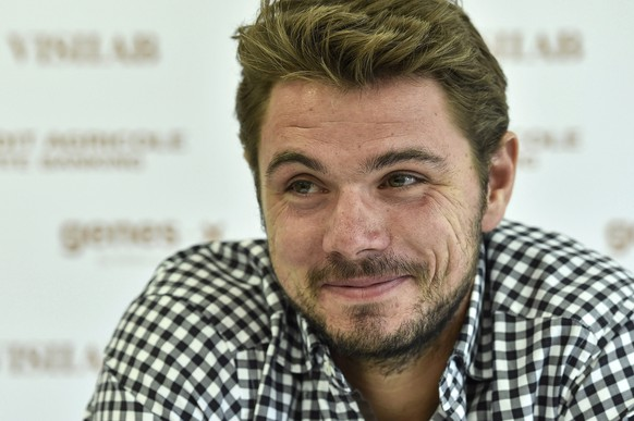 epa04330171 Swiss tennis player Stanislas Wawrinka smiles during a press conference at the Suisse Open tennis tournament in Gstaad, Switzerland, 25 July 2014.  EPA/PETER SCHNEIDER