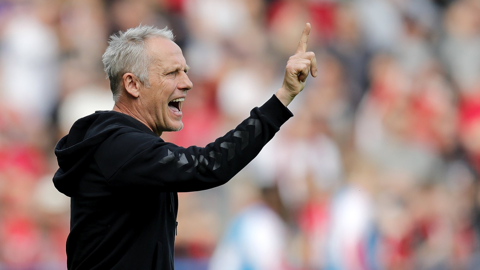 epa06699031 Freiburg's head coach Christian Streich reacts during the German Bundesliga soccer match between SC Freiburg and FC Cologne in Freiburg, Germany, 28 April 2018.  EPA/RONALD WITTEK (EMBARGO CONDITIONS - ATTENTION: Due to the accreditation guidelines, the DFL only permits the publication and utilisation of up to 15 pictures per match on the internet and in online media during the match.)