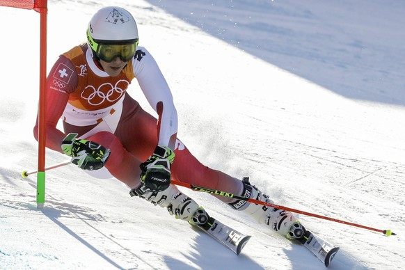 Wendy Holdener, of Switzerland, attacks a gate during the first run of the Women's Giant Slalom at the 2018 Winter Olympics in Pyeongchang, South Korea, Thursday, Feb. 15, 2018., Thursday, Feb. 15, 2018. (AP Photo/Michael Probst)