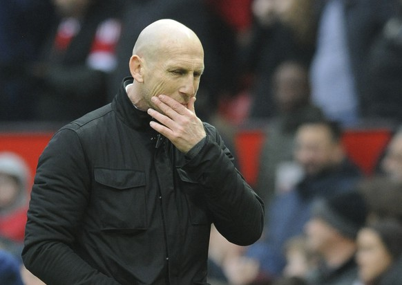 Reading's manager Jaap Stam walks off the pitch at half time during the English FA Cup Third Round match between Manchester United and Reading at Old Trafford in Manchester, England, Saturday, Jan. 7, 2017. (AP Photo/Rui Vieira)