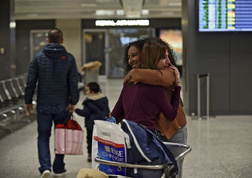 epa05773299 Roslyn Sinha (R), 30, hugs her immigration attorney Elinor K. Tesfanariam, who has been volunteering and offering legal help at Dulles International Airport in Sterling, Virginia, USA, 05 February 2017. Sinha is Iraqi citizen married to a US citizen and has lived with her husband in Texas for the last six months and is in the process of applying for her green card. The day US President Trump ordered the travel ban, Sinha was flying to Dubai to visit her mother who is in the hospital after suffering from a stroke and was not able to return to the US.  A federal judge on 03 February issued a temporary restraining order blocking enforcement of US President Trump's executive order from 27 January that banned people from seven mainly Muslim countries from entering the United States.  EPA/Astrid Riecken
