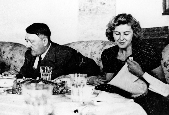 Undated picture of the German Fuehrer Adolf Hitler and his mistress Eva Braun while dining. Hitler acquired great personal wealth and a luxurious lifestyle masked from the German public beneath the Nazi dictator's image as an austere leader determined to revive his country, according to a new television documentary. (KEYSTONE/AP Photo/Eva Braun's picture Album/HO)  ===  ===