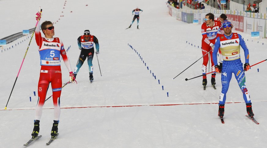 Norway's Johannes Hoesflot Klaebo, left, outsprints second placed Italy's Federico Pellegrino, right, and third placed Russia's Gleb Retivykh, 2nd right, to win the men's cross-country sprint event, at the Nordic Ski World Championships in Seefeld, Austria, Thursday, Feb. 21, 2019. (AP Photo/Matthias Schrader)