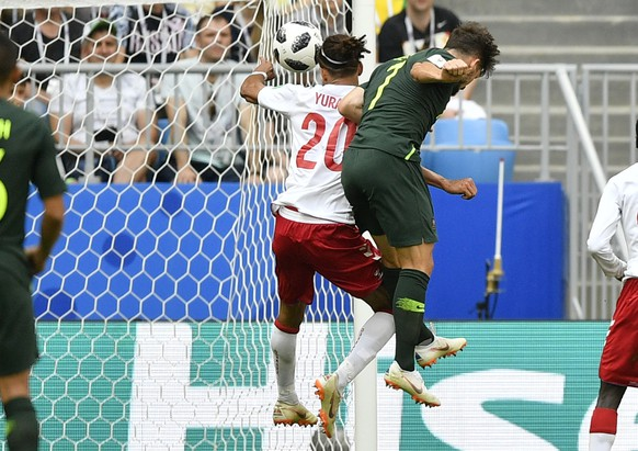 Denmark's Yussuf Yurary Poulsen playes the ball with his hand during the group C match between Denmark and Australia at the 2018 soccer World Cup in the Samara Arena in Samara, Russia, Thursday, June 21, 2018. (AP Photo/Martin Meissner)