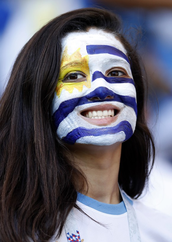 epa06824662 Supporter of Uruguay during the FIFA World Cup 2018 group A preliminary round soccer match between Uruguay and Saudi Arabia in Rostov-On-Don, Russia, 20 June 2018.  (RESTRICTIONS APPLY: Editorial Use Only, not used in association with any commercial entity - Images must not be used in any form of alert service or push service of any kind including via mobile alert services, downloads to mobile devices or MMS messaging - Images must appear as still images and must not emulate match action video footage - No alteration is made to, and no text or image is superimposed over, any published image which: (a) intentionally obscures or removes a sponsor identification image; or (b) adds or overlays the commercial identification of any third party which is not officially associated with the FIFA World Cup)  EPA/SHAWN THEW   EDITORIAL USE ONLY