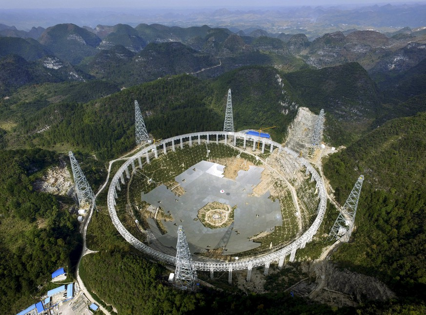 A 500-metre (1,640-ft.) aperture spherical telescope (FAST) is seen under construction among the mountains in Pingtang county, Guizhou province, China, November 26, 2015. The telescope, which will be the largest in the world, will be put in use by September 2016, according to local media. Picture taken November 26, 2015. REUTERS/Stringer  CHINA OUT. NO COMMERCIAL OR EDITORIAL SALES IN CHINA       TPX IMAGES OF THE DAY