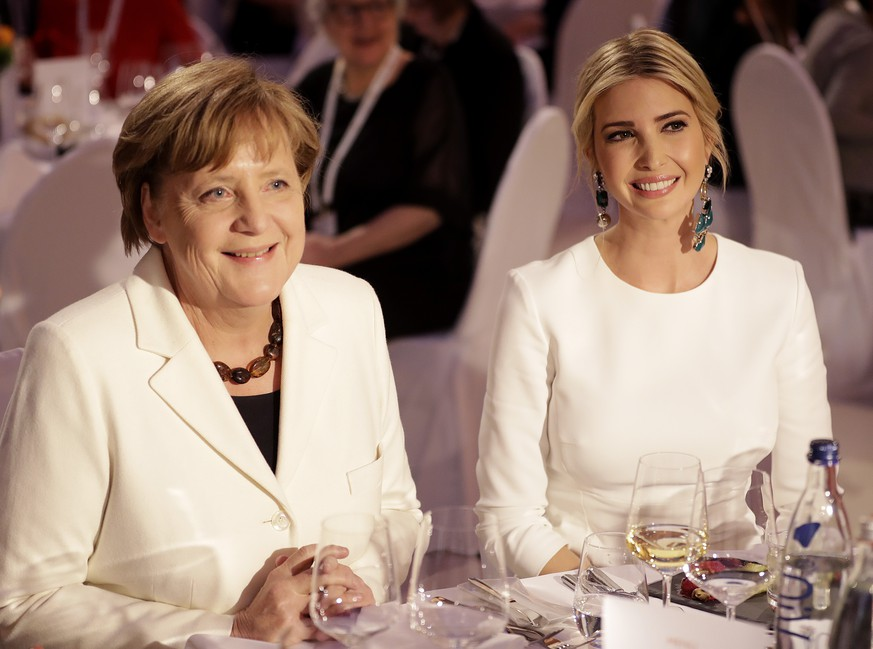 Ivanka Trump, daughter and adviser of U.S. President Donald Trump, left, sits next to German Chacellor Angela Merkel during a dinner after she participated in the W20 Summit in Berlin Tuesday, April 25, 2017. (AP Photo/Michael Sohn, pool)