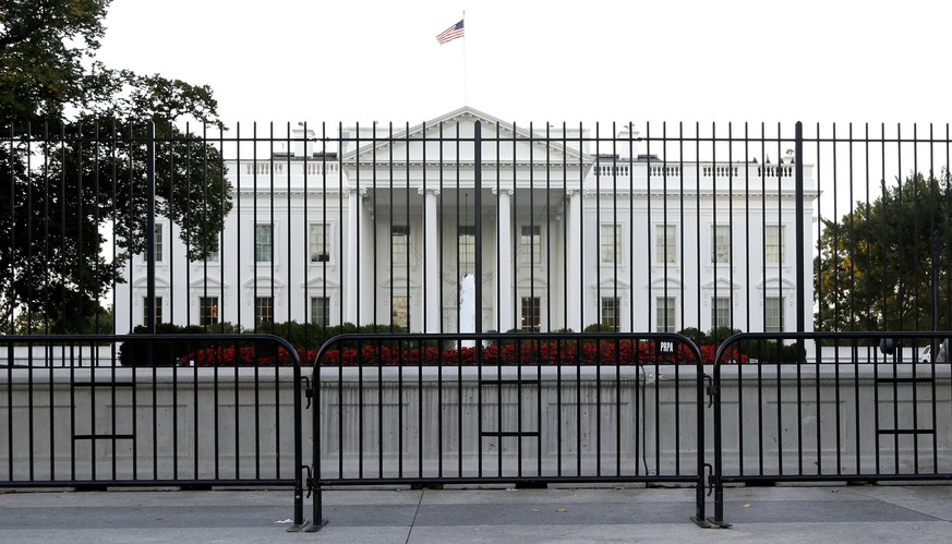 The perimeter fence sits in front of the White House fence on the North Lawn along Pennsylvania Avenue in Washington, Monday, Sept. 22, 2014. The Secret Service tightened their guard outside the White House after Friday's embarrassing breach in the security of one of the most closely protected buildings in the world. A man is accused of scaling the White House perimeter fence, running across the lawn and entering the presidential mansion before agents stopped him. (AP Photo/Carolyn Kaster)