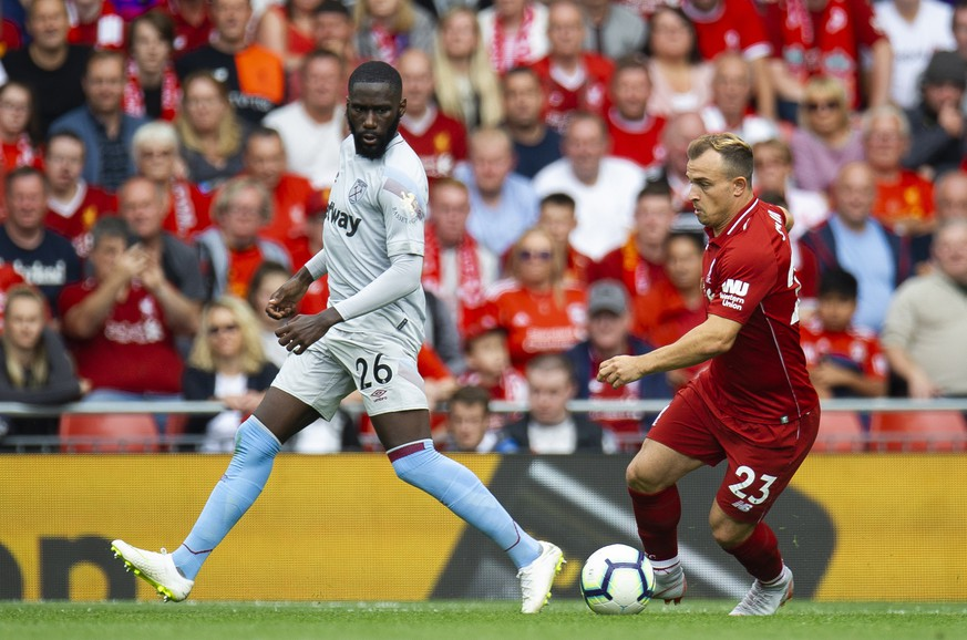 epa06945854 West Ham United's Arthur Masuaku (L) in action with Liverpool's Xherdan Shaqiri (R) during the English Premier League soccer match between Liverpool and West Ham at the Anfield in Liverpool, Britain, 12 August 2018.  EPA/PETER POWELL