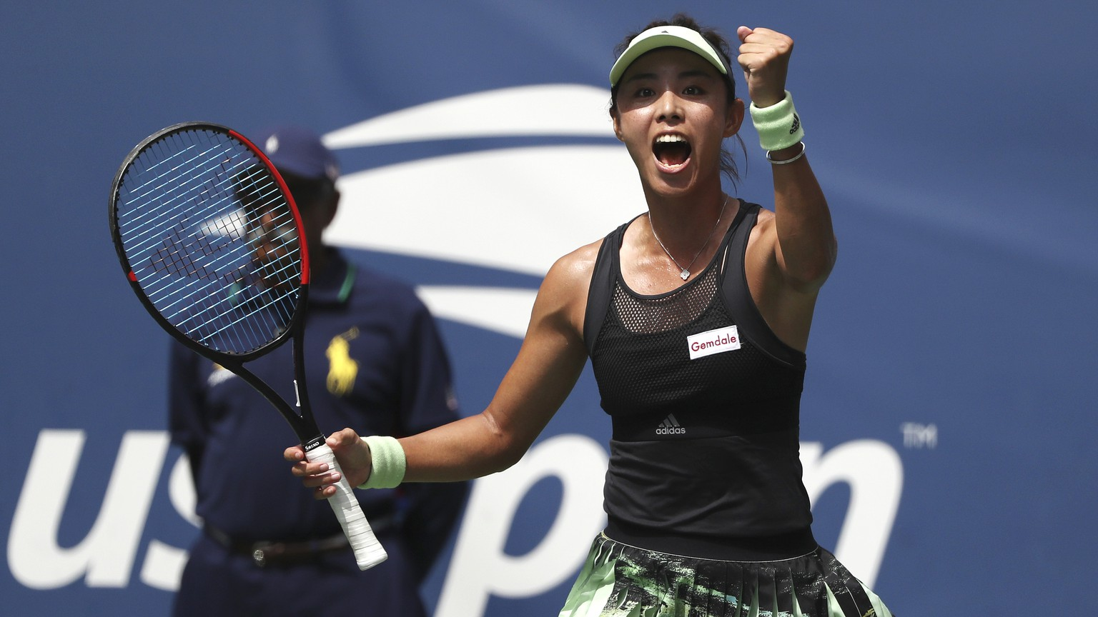Qiang Wang, of China, reacts after defeating Ashleigh Barty, of Australia, during round four of the US Open tennis championships Sunday, Sept. 1, 2019, in New York. (AP Photo/Kevin Hagen)