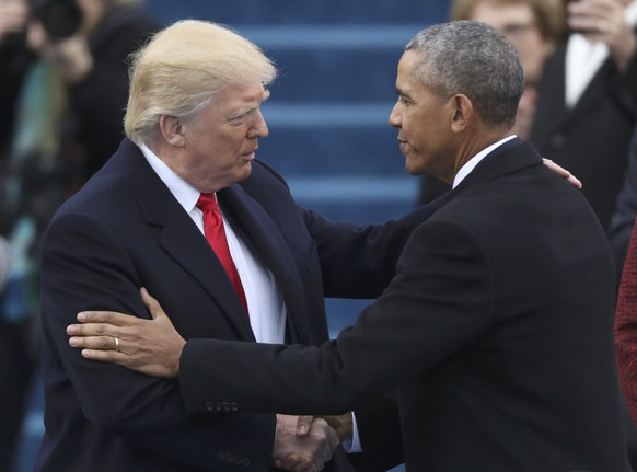 U.S. President-elect Donald Trump greets outgoing  President Barack Obama (R) before Trump is inaugurated during ceremonies on the Capitol in Washington, U.S., January 20, 2017. REUTERS/Carlos Barria