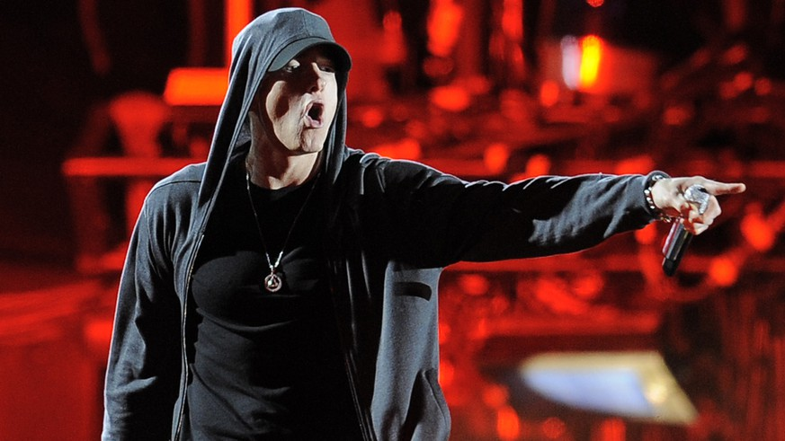 "FILE - In this April 15, 2012 file photo Eminem performs at the 2012 Coachella Valley Music and Arts Festival in Indio, Calif. Eminem gave his estranged mom quite the Mother's Day gift, releasing a music video for an apologetic song that depicts her struggles raising the rebellious rapper. The Detroit rapper released the video for ""Headlights"" featuring fun.'s Nate Ruess on Sunday, May 11, 2014. The song, released on Eminem's 2013 album ""The Marshall Mathers LP 2,"" is an extended apology to his mother Debbie for the difficulties he caused her over the years. (AP Photo/Chris Pizzello, File)"