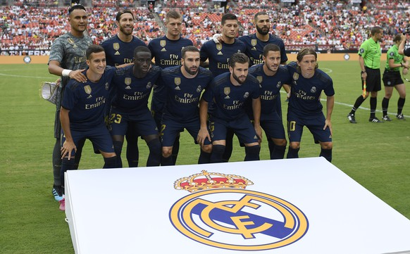 Real Madrid poses for the team picture before an International Champions Cup soccer match against Arsenal, Tuesday, July 23, 2019, in Landover, Md. The game ended 2-2 and Real Madrid won 3-2 after penalty kicks. (AP Photo/Nick Wass)
