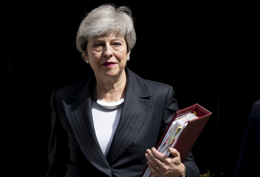 epa07591467 British Prime Minister Theresa May leaves 10 Downing Street to attend Prime Minister's Questions (PMQs) in the central London, Britain, 22 May 2019. Theresa May in a speech on 22 May 2019 stated that she is considering tighter customs ties with the European Union to try to win over Labour lawmakers for her Brexit deal , but the strategy risks angering Brexiteers in her government.  EPA/WILL OLIVER