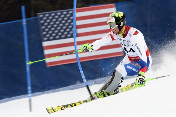 epa04621776 Justin Murisier of Switzerland in action during the first run of the men's slalom race at the 2015 Alpine World Skiing Championships in Beaver Creek, Colorado, USA, 15 February 2015.  EPA/JEAN-CHRISTOPHE BOTT