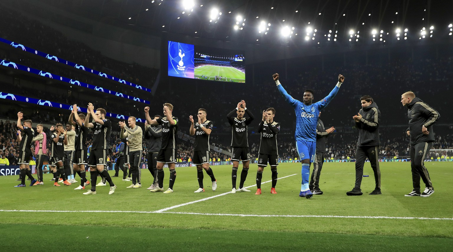 Ajax players celebrate after the final whistle of the Champions League, semifinal first leg soccer match at the Tottenham Hotspur Stadium, London, Tuesday April 30, 2019. Ajax beat Tottenham 1-0. (Mike Egerton/PA via AP)